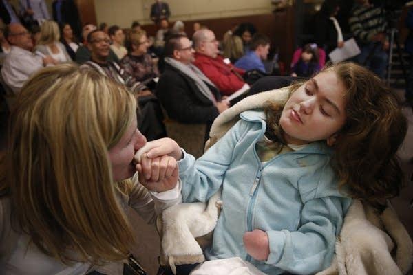 MaryAnn Nelson kisses daughter's hand