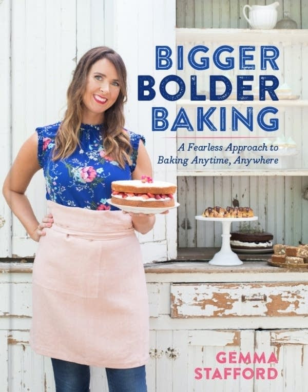 book cover with author Gemma Stafford in kitchen holding extravagant cake