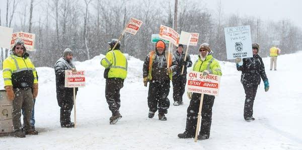 Teamsters Local 320 members picketing.