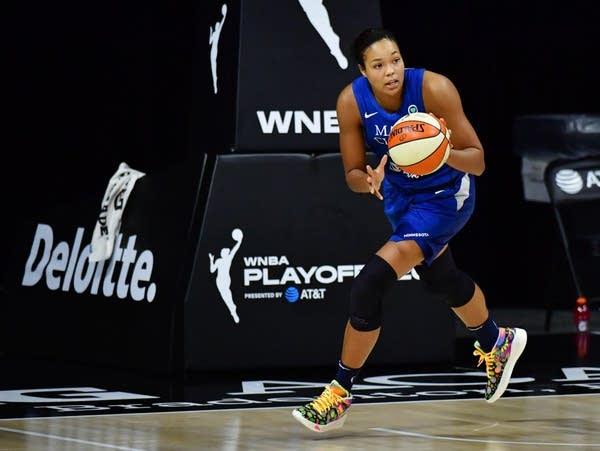 Napheesa Collier catches a basketball
