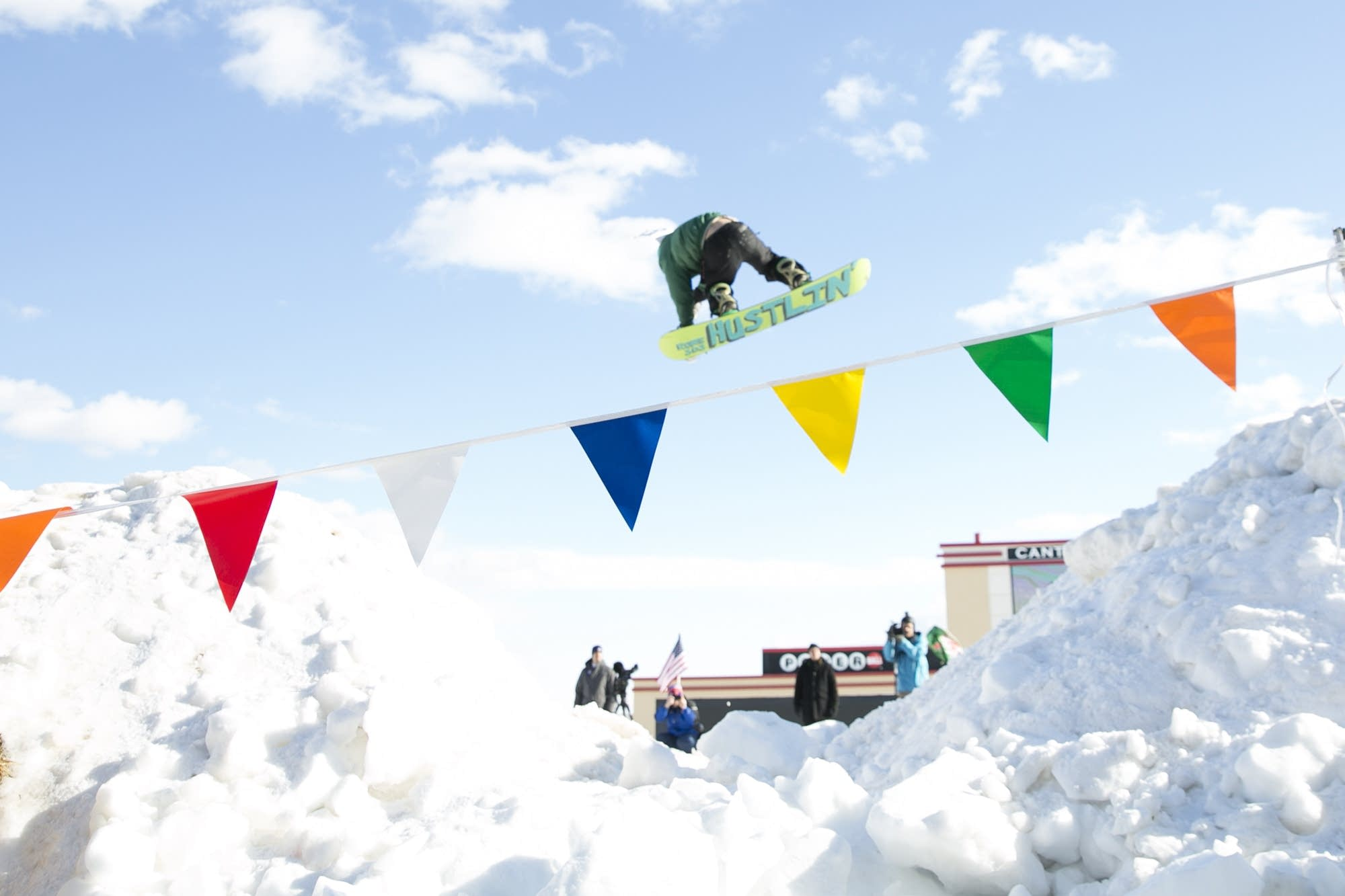 A snowboarder pulls off a trick during the freestyle part of the event.