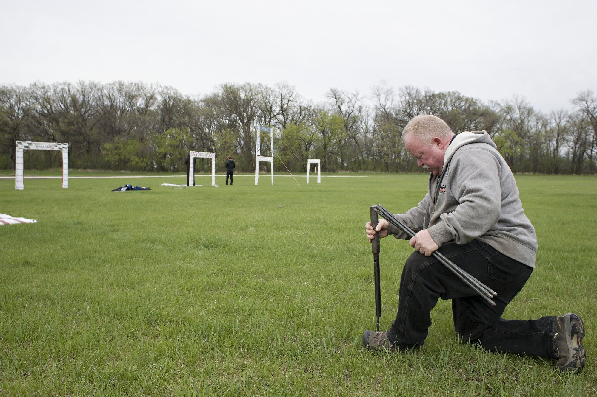 Shawn Spears of Moorhead, Minn., helps set up a course before a drone race.