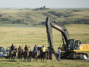 Tribal members approach security near the Standing Rock reservation.
