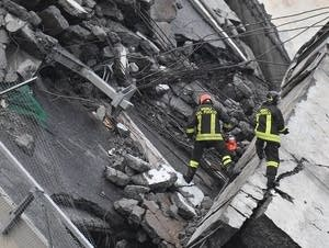 Rescuers among the rubble of the collapse Morandi Bridge.