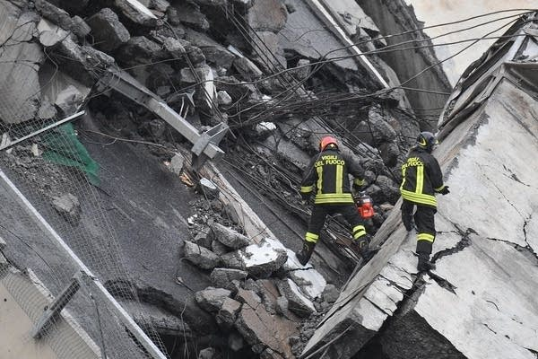 Rescuers among the rubble of the collapse Morandi Bridge.