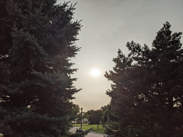 A Thick elevated smoke layer above the Twin Cities dimmed the sunshine Monday.