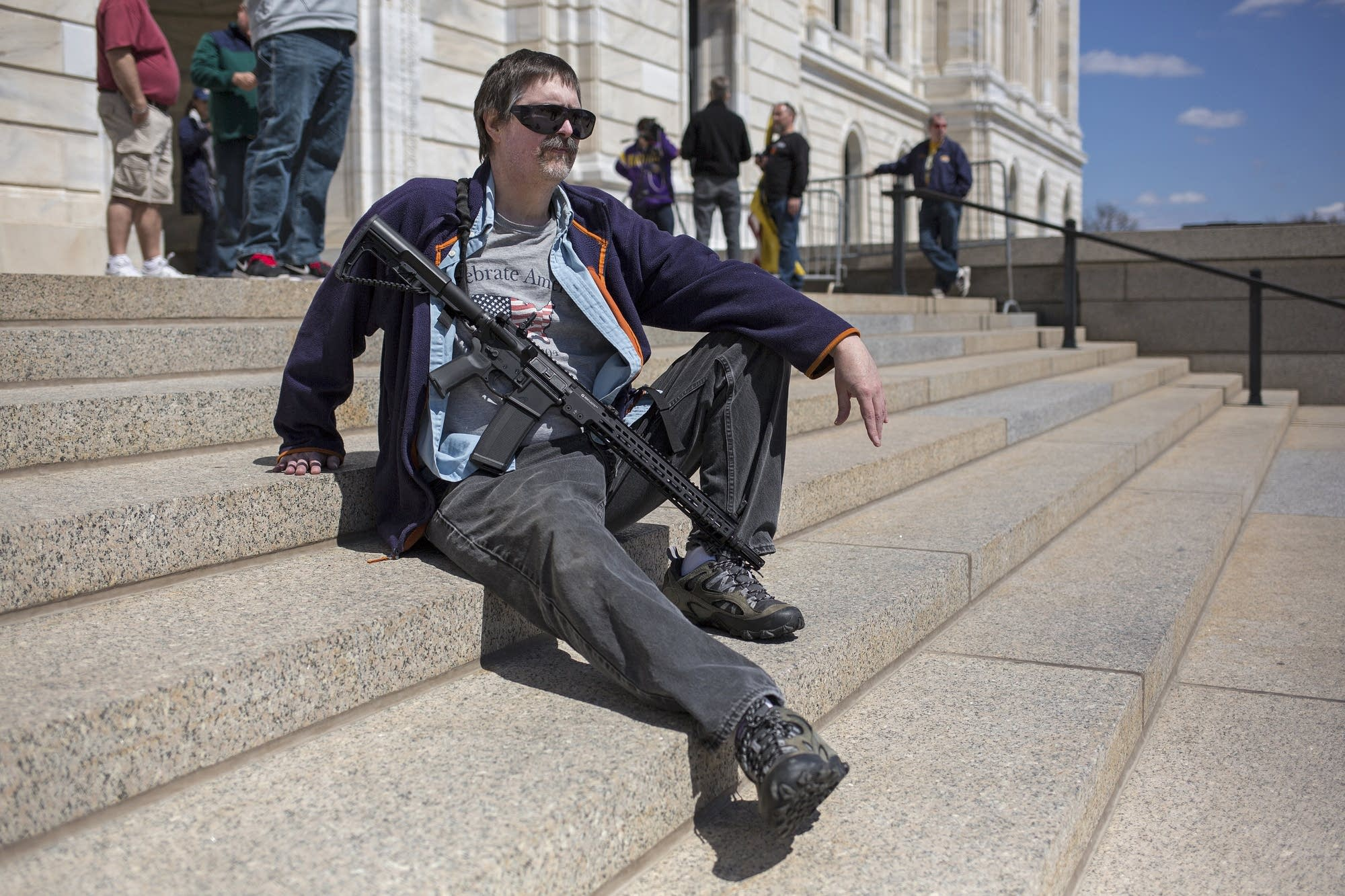 James Day of Mankato carries a custom AR-14 at the rally.