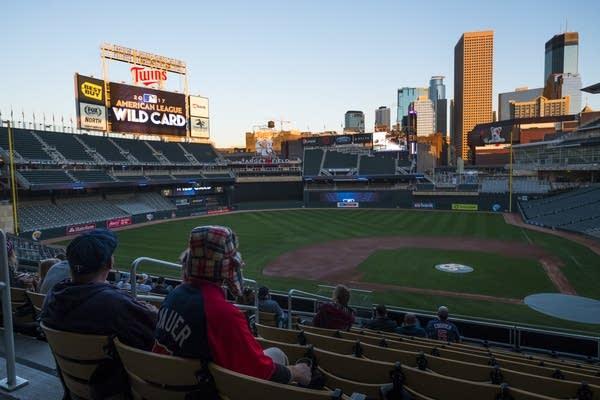 Fans watch the sun set over Minneapolis.