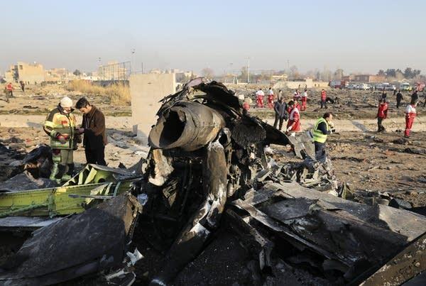 Debris at the scene where a Ukrainian plane crashed.