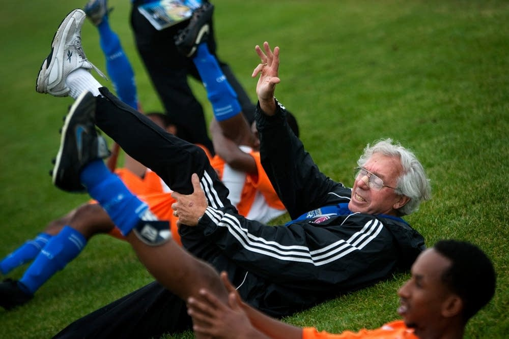 Stretching with his players