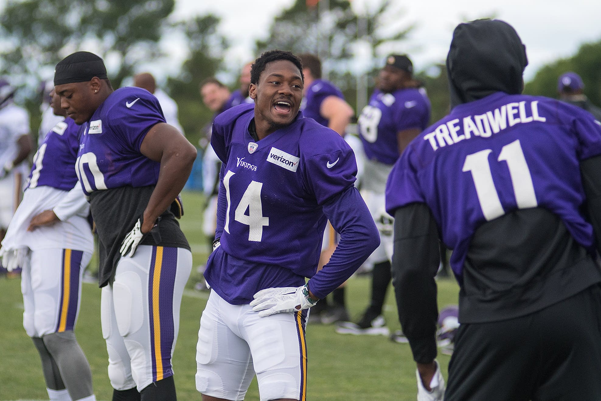 Stefon Diggs (14) jokes around with his Vikings teammates.