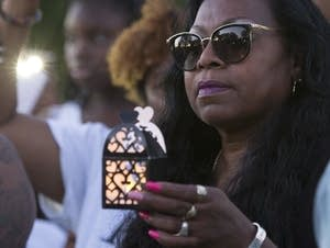 Valerie Castile holds a lantern during a memorial