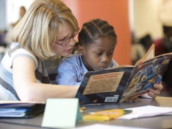 Teacher tutoring child