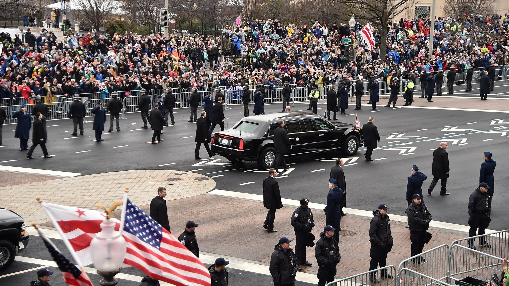 The presidential limousine turns onto Pennsylvania Avenue