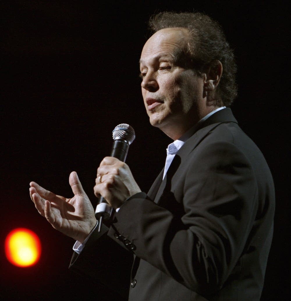 Comedian Billy Crystal performs