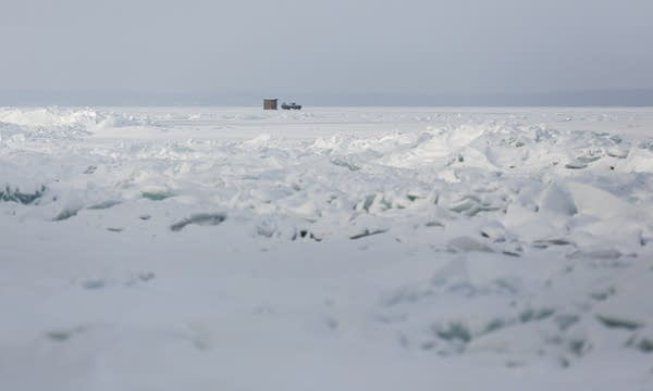 Odle moves an ice house onto Mille Lacs.