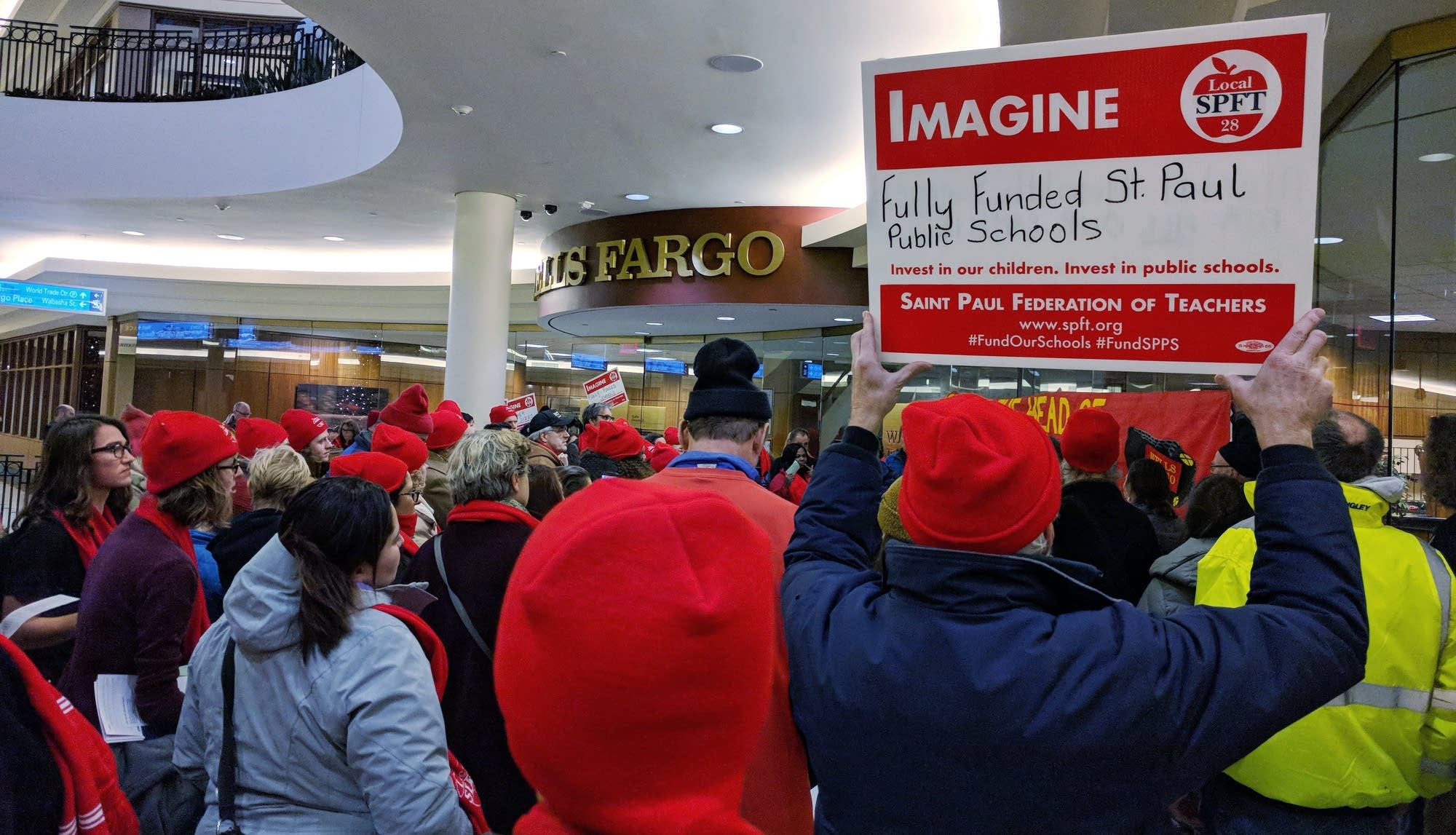 Members of the St. Paul teachers union protest outside Wells Fargo.