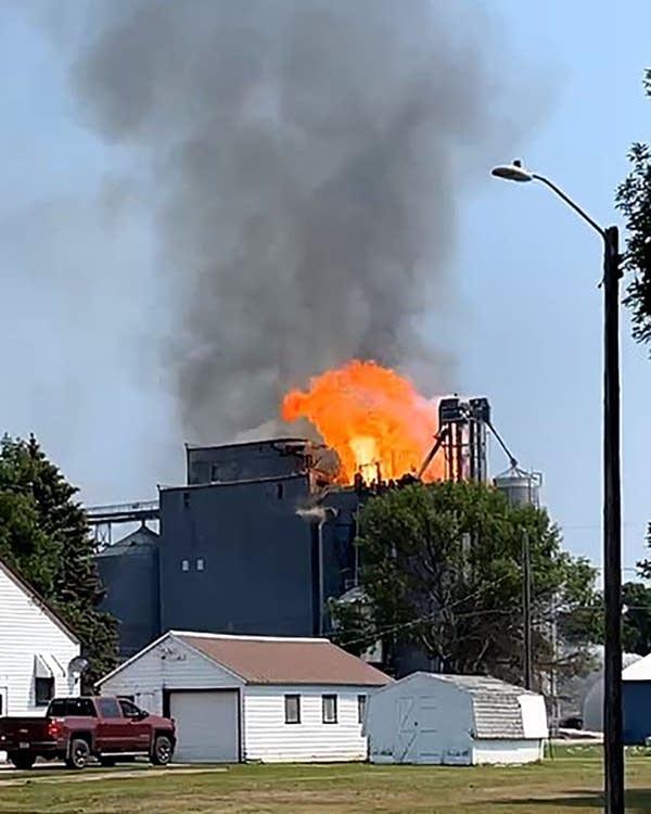A fire burns at a grain elevator