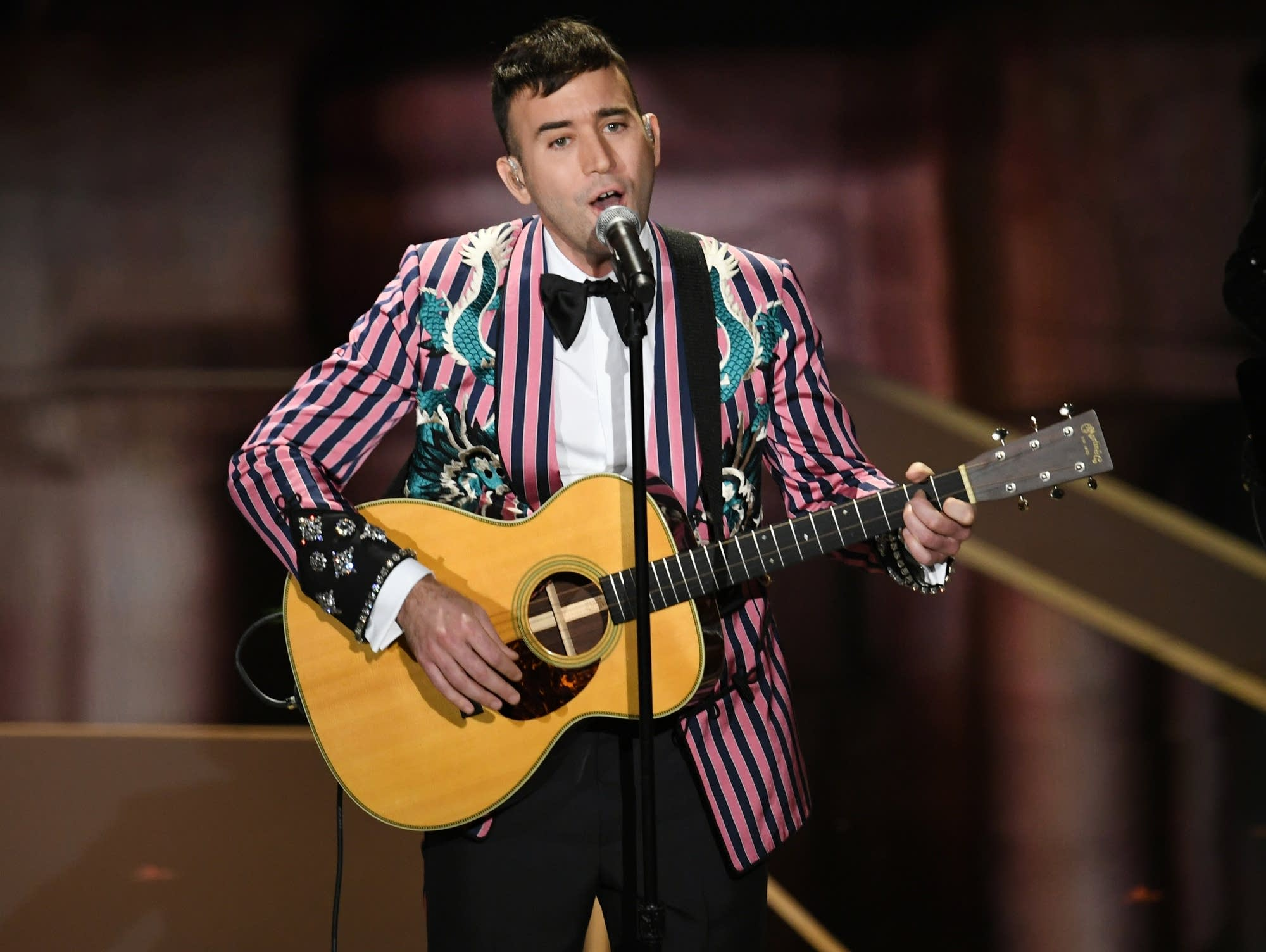 Sufjan Stevens performs at the 90th Academy Awards.