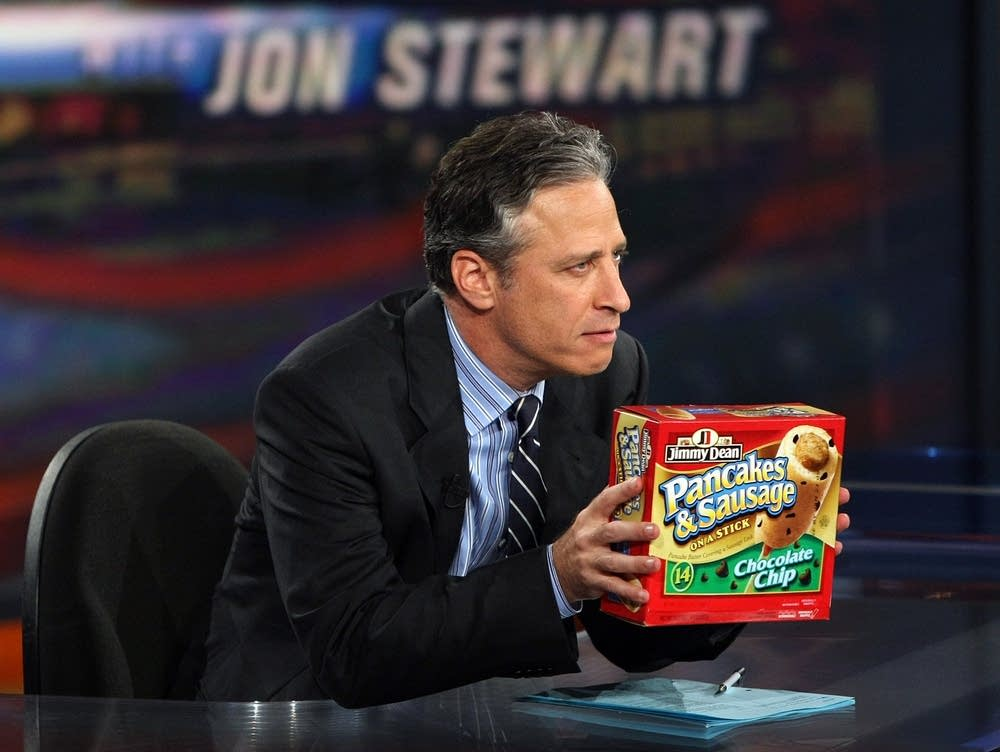 Jon Stewart holds a well-known 'on a stick' food