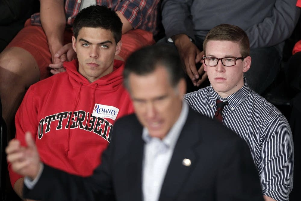 Students listen to Romney