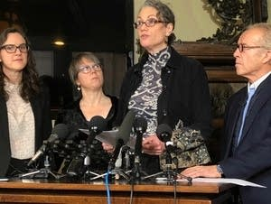 Laura Stearns, the plaintiff (second from right)