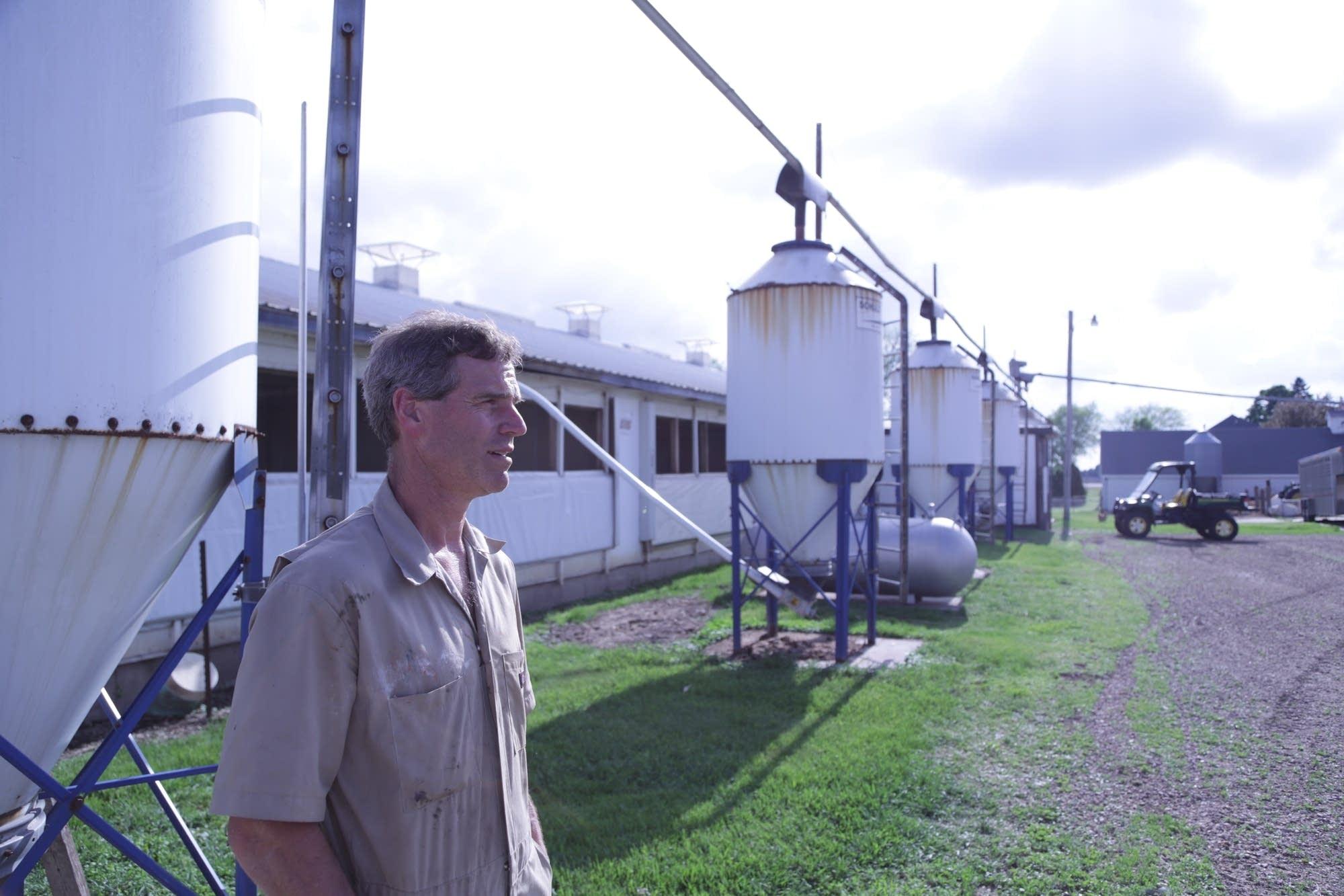 Dale Stevermer stands outside on his hog farm.