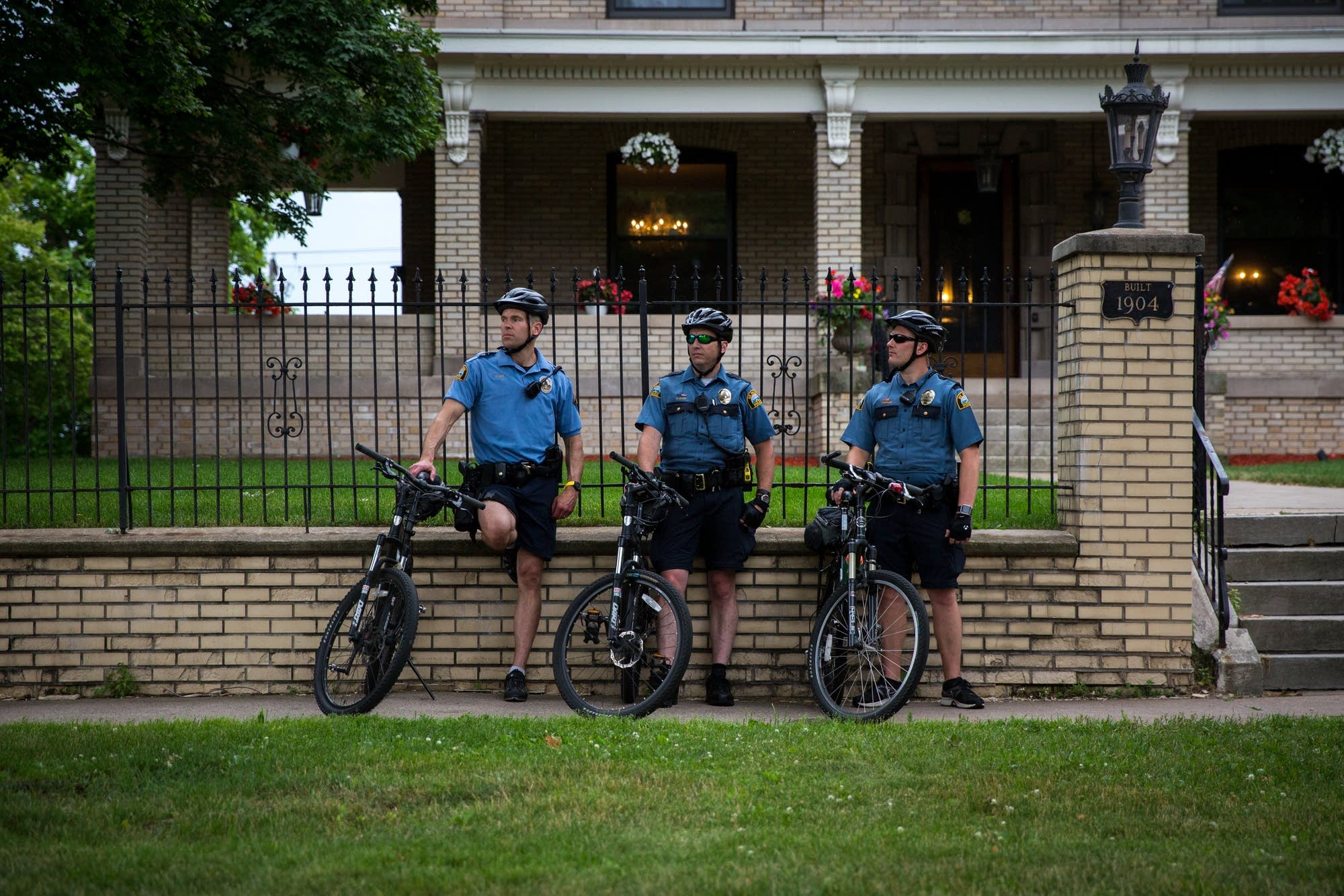 Officers watch a protest after the death of Philando Castile