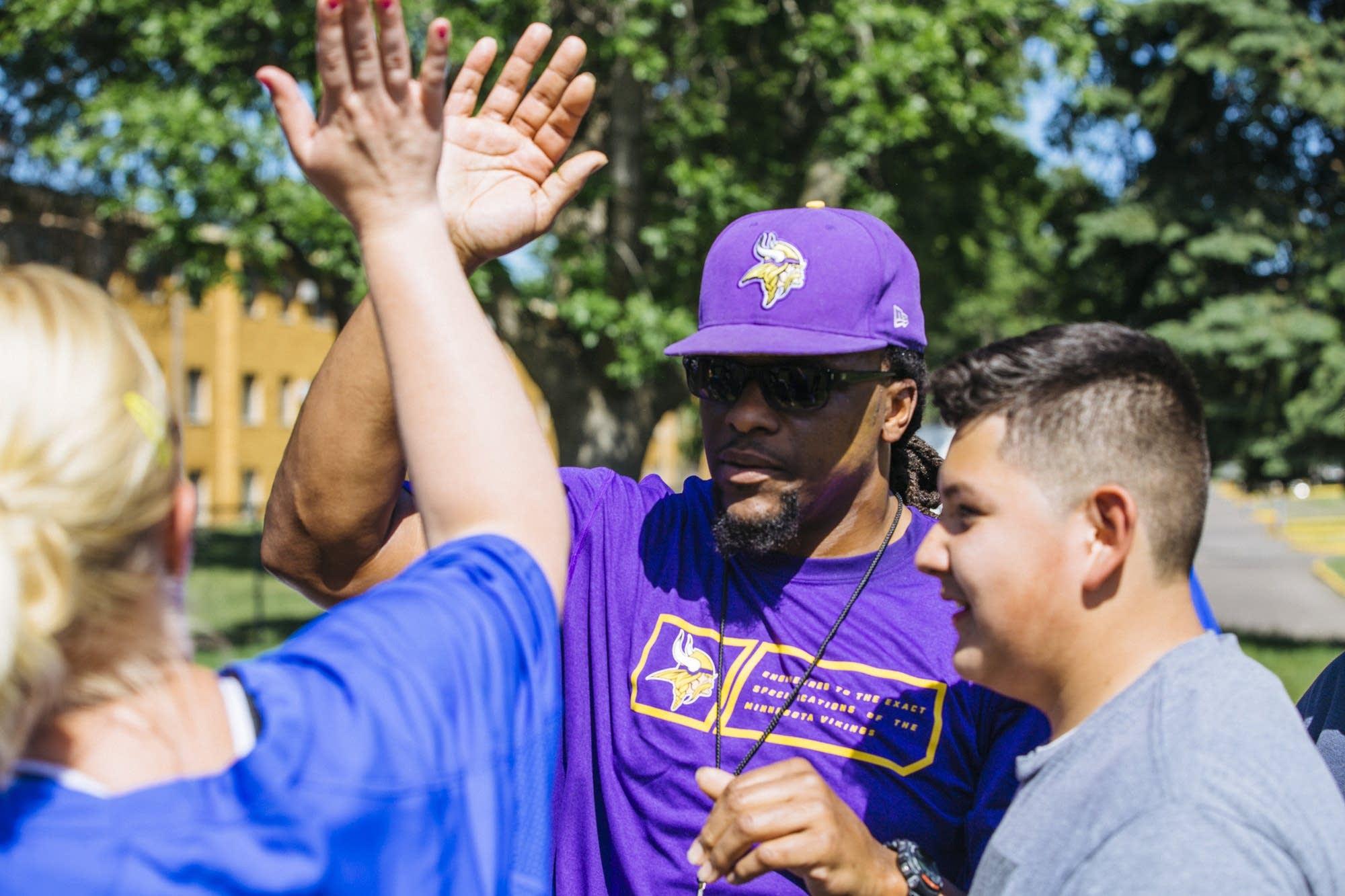 E.J. Henderson gives a high-five