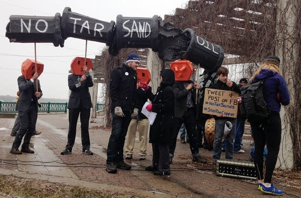 Activists protest piping more oil from Canada
