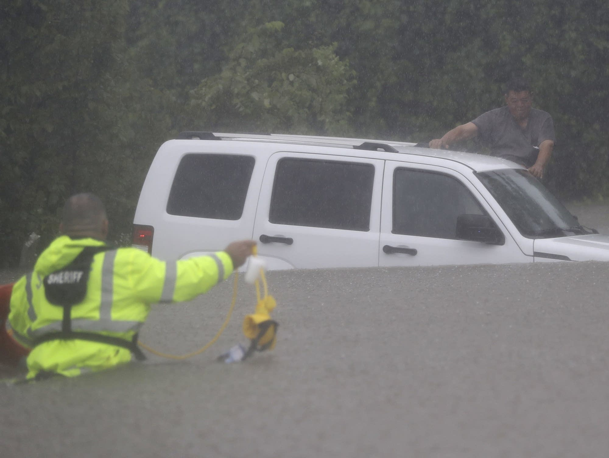 A man waits to be rescued by the Harris County Sheriff's Department