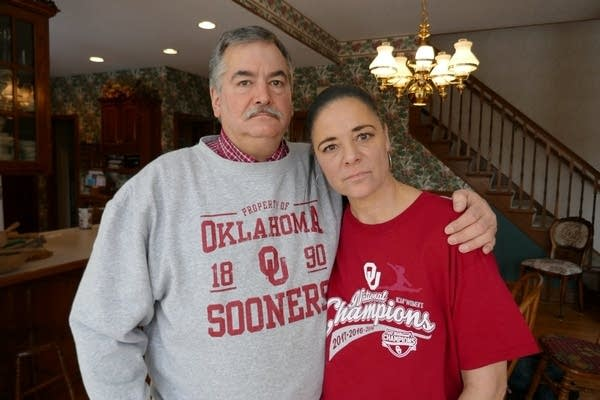 Maggie Nichols' parents Gina and John, in their home