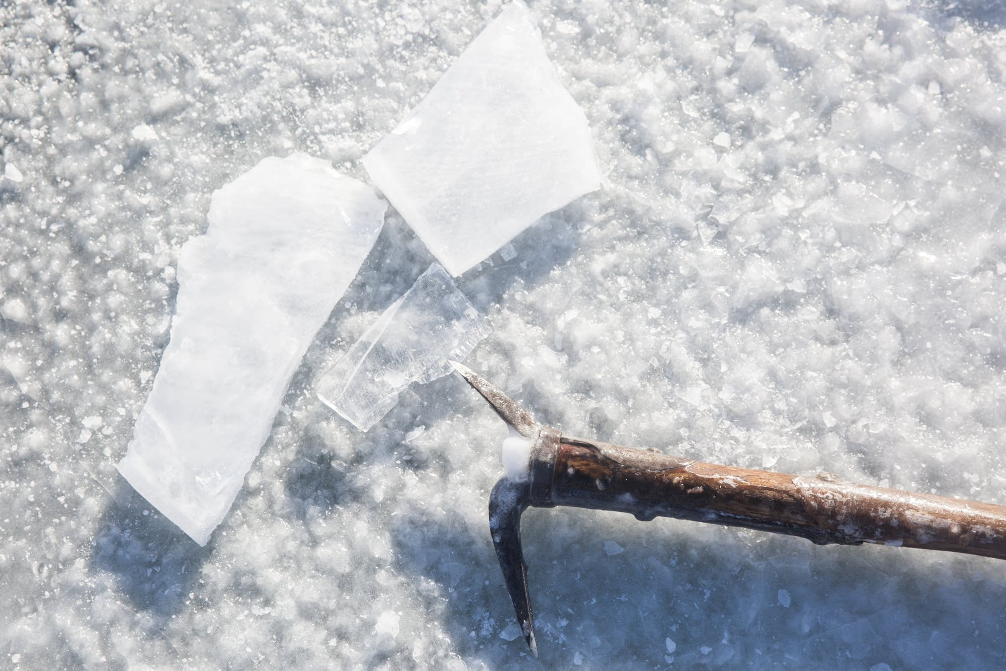 A ice pick sits on the frozen surface of Green Lake