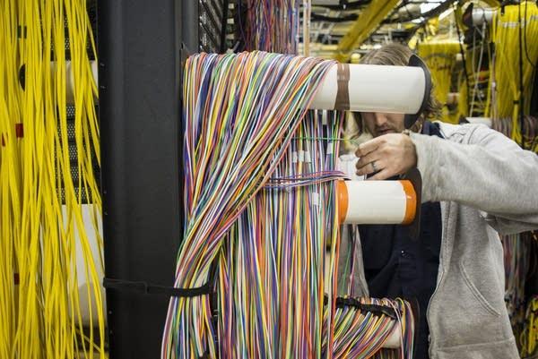 US Internet employee separates fiber optic cables.