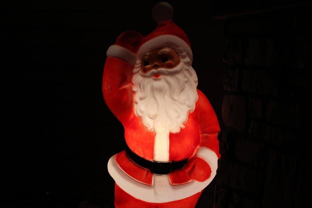 David Cazares makes sure to place a black Santa ou