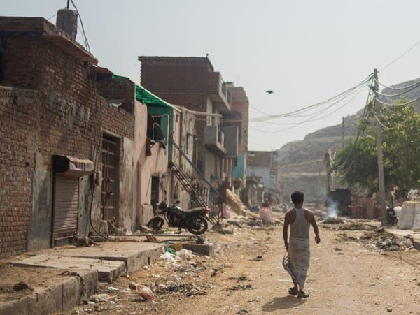 Sheikh Rahim, 36, walks from the slum where he lives