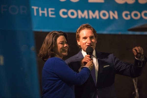 DFL Candidates Angie Craig and Dean Phillips share a moment on stage