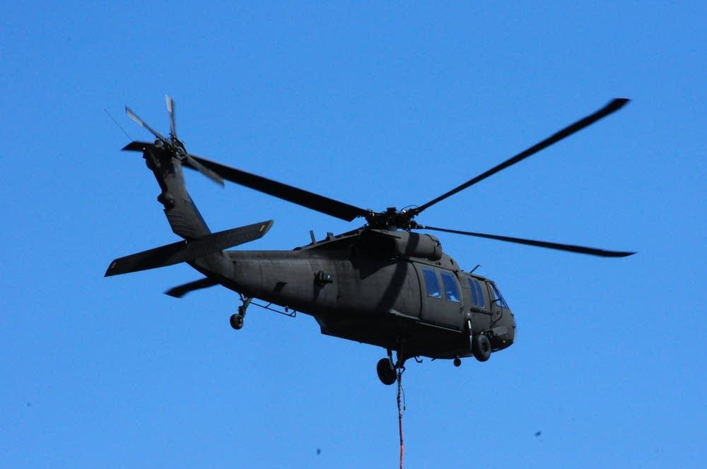 Blackhawk helicopter delivers a 'sand balloon'