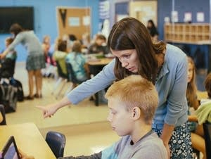 Cecilia Delbene assists 11-year-old Hayden Staloch.