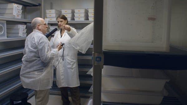 NPR health correspondent Rob Stein with lab head, Ruth Mueller.