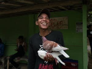 Sumarjan is bursting with excitement after his pigeon wins the day's race