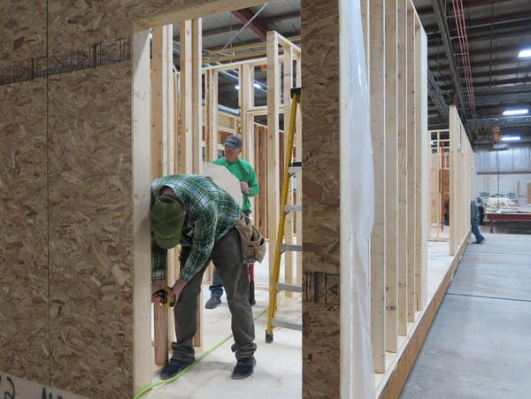 At Dynamic Homes, workers build homes year-round indoors.