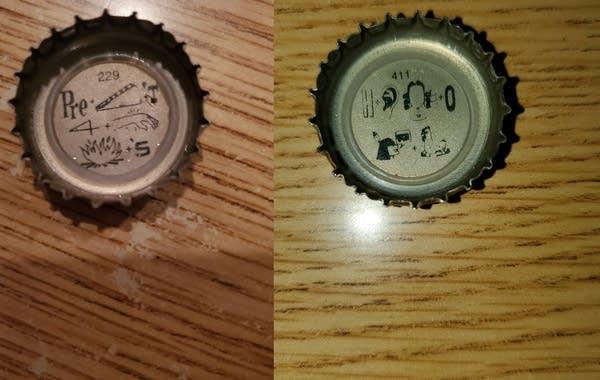 Two Rainier bottle caps showing their pictogram puzzles