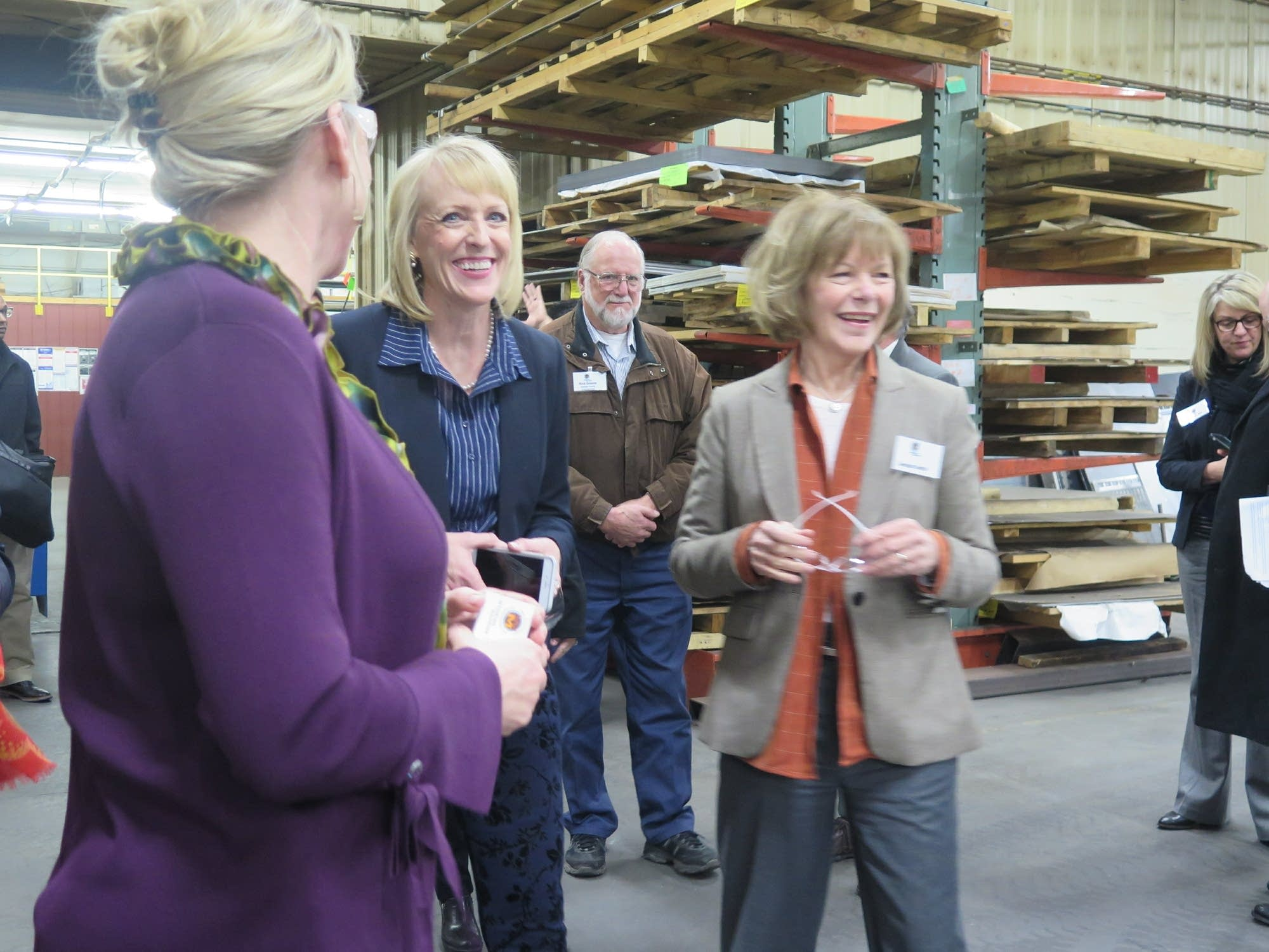 Traci Tapani leads U.S. Sen. Tina Smith on a tour in 2018.