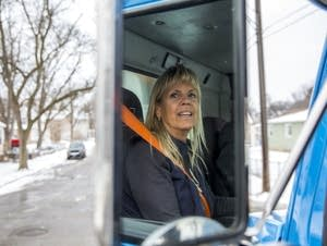 Vicky Stitch sits in the driver's seat of her snow plow.