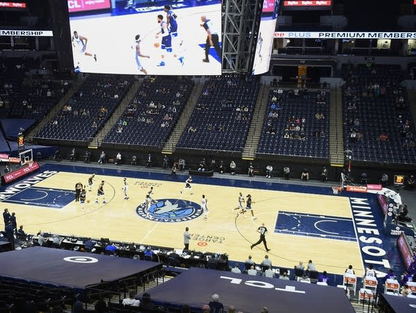 People attend a Minnesota Timberwolves game
