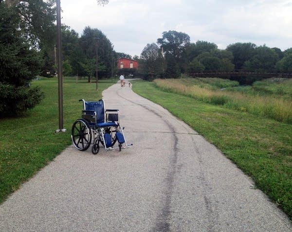Abandoned wheelchair on walking trail