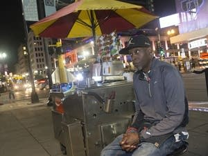 Toby Rogers, Sr., waits for customers along Henn. Ave. at a hot dog stand.