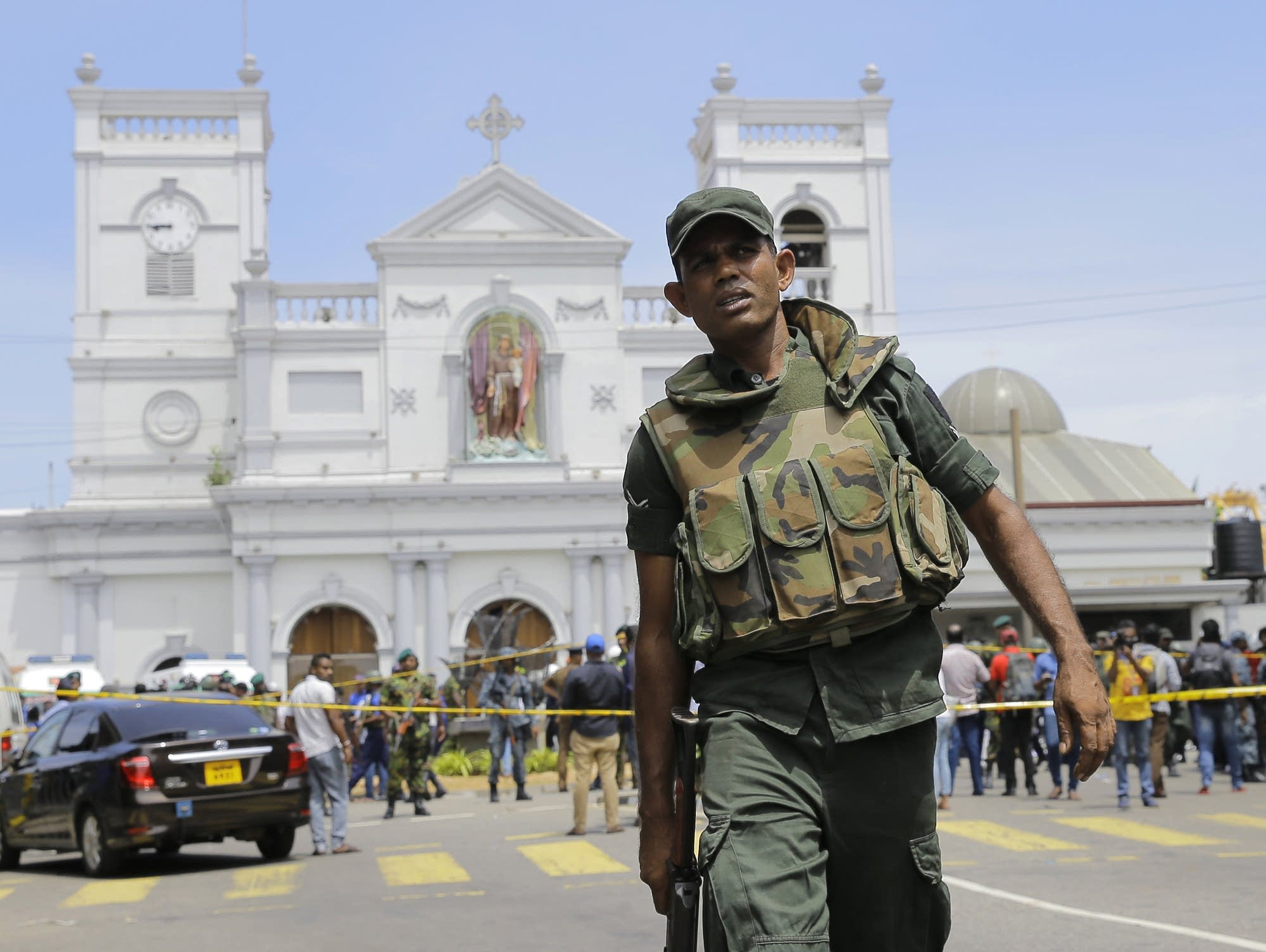 Sri Lankan soldiers secure the area around St. Anthony's Shrine