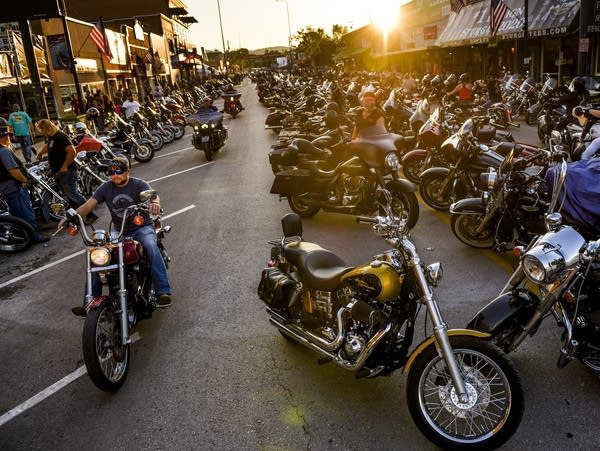 Motorcyclists ride down Main Street in Sturgis